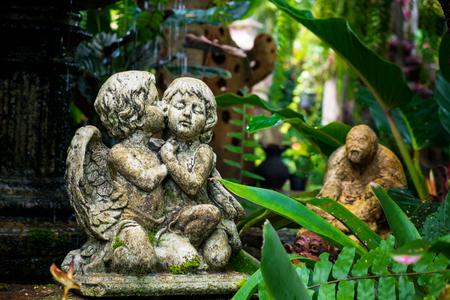 cherubs: Cute couple cupid Statue in the garden, garden decoration