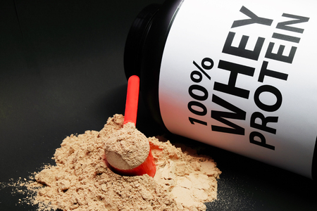 Whey Protein Powder in measuring scoop. Bodybuilding Nutrition Supplements. 스톡 콘텐츠