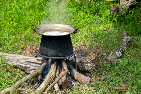 Tribal people cooking style outdoor with Wood firewood Stock Photo