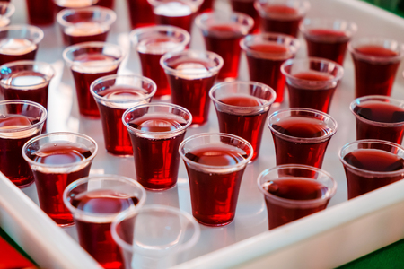 Grape juice in the Plastic cups for Holy Communion in the Church.