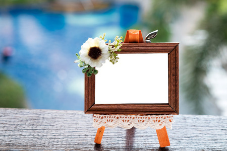 Small Cute Wood Picture Frame Outdoor by Side of the Swimming Pool. Imagens