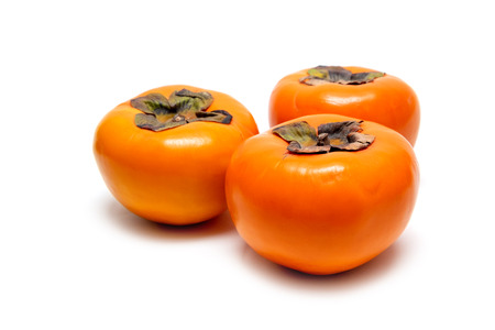 Group of Fresh Persimmon on iSolated White Background. Healthy Fruit.