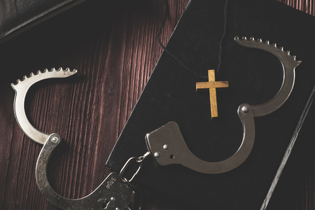 Simple Wood Cross and Unchain Handcuffs. Concept of Jesus Christ the Savior Liberate People from Sin. Stock Photo