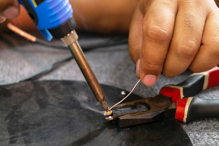 Close up of Microelectronics Engineering. Soldering Lead Repairing Microphone Wire Technology Concept.