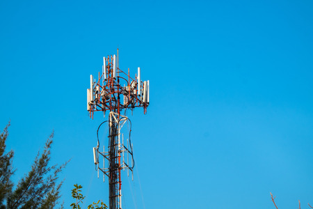 Cell Site Post in the Clear Blue Sky with Clouds. Telecommunication Technology Pillar. Banco de Imagens