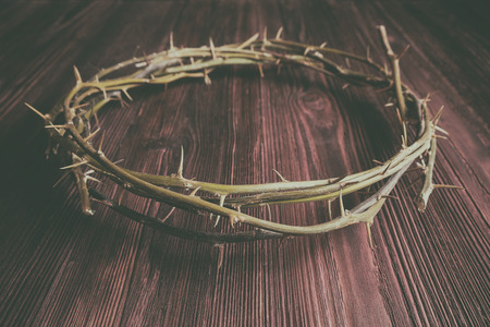 Jesus Crown Thorns on Old and Grunge Wood Background. Vintage Retro Style Added.