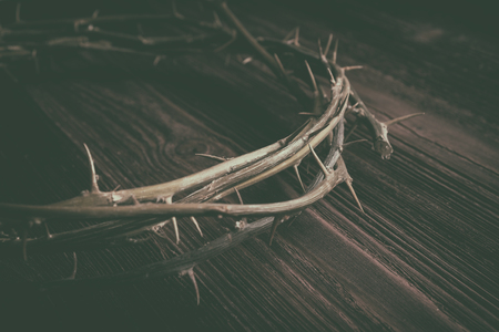 Jesus Christ Crown Thorns on Old Wood Table Background. Stock Photo