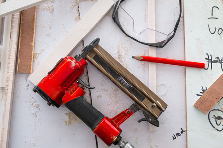 Nail Gun in the Furniture industrial Shop for Furniture Builds, Carpentry Tools.