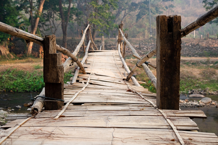 Old and Dangerous Tribal Bamboo Bridge Cross Over the River, Local Area in Thailand. 写真素材