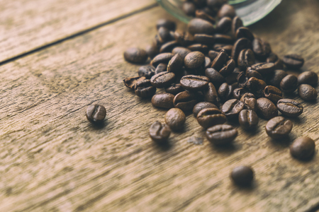 Coffee Beans on the Old Wood Table. Vintage Retro Style Picture Added. 写真素材