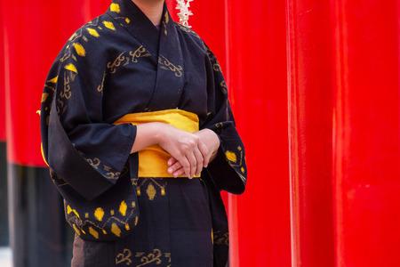 Girl Wearing Japan Culture Kimono Fushimi. Standing in the Religous Temple Walk path.