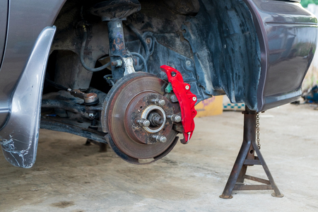 Car Brake and Suspension System Maintenance in the Local Area Garage. 写真素材