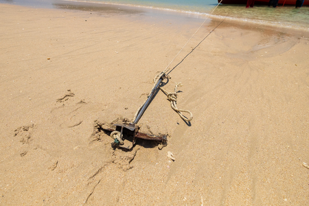 Small Anchor in Beach Sand for Parking Tourism Boat in the Island. 写真素材