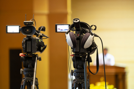 Professional Videographer Recording Seminar Meeting with Professional Camcoder and Boardcasting.