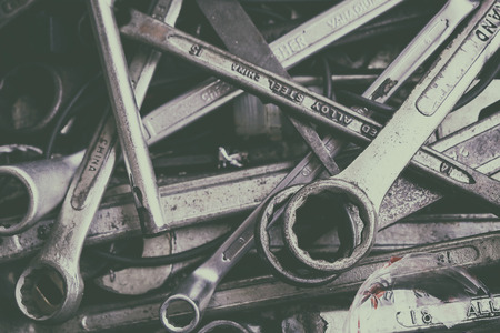 Many Old and Used Box Wrench in the Tools Box in the Garage. Vintage Style Picture Added. 写真素材