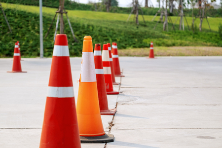 Plastic Traffic Cones Signaling to Encloses in the Car Parking Area.