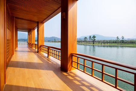 Beautiful Japanese Conservative Wood Terrace and Fence with Outdoor Pagola and Lake. Stock Photo
