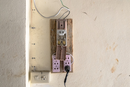 Old and Unsafe Vintage Style Electronic Plastic Circuit Breaker. Concept of Safety in the Work Site.