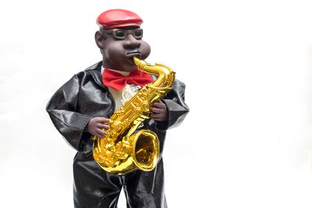 Cute Gentle Man Doll Playing Saxophone Instrument on iSolated White Background.