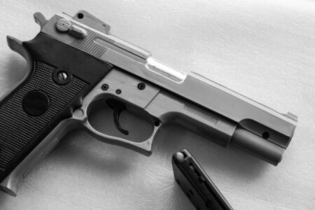 BB Gun, Old Airsoft Pistol Toy and Magazine with BB Gun Bullets on White Background. Black and White Color.