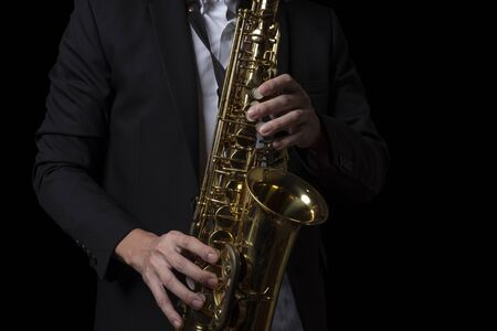 Male Jazz Saxophone Player Performance on the Stage. iSolated Black Background. 写真素材 - 132125539