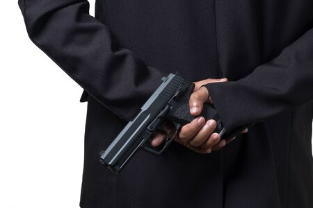 Businessman Holding a Pistol Gun. Concept Picture of Assassin or Smart Bodyguard.