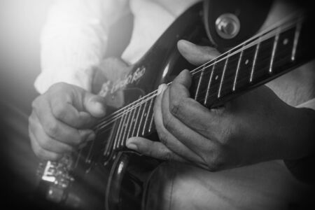 Male Guitar Musician Playing His Electric Guitar. Flare Added. Stok Fotoğraf