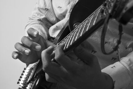 Male Guitar Musician Playing His Electric Guitar. Flare Added. 写真素材