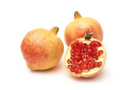 Ripe and Fresh Pomegranate Fruit on iSolated White Background.