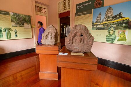 2019-10-19 Lopburi Style Buddha Statue in Niches on the Wall in the Ratchaburi Museum, Thailand.