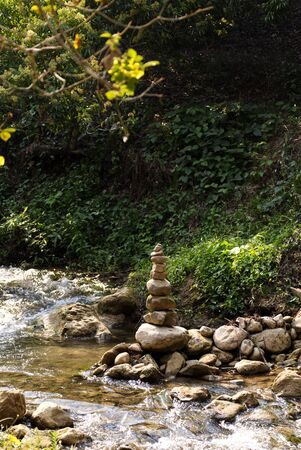 Rock Stack, Stone Cairn Along Sign Small River in the Beautiful Forrest. Reklamní fotografie
