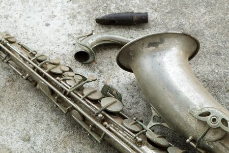 Beautiful Old and Antique Aged Tenor Saxophone on the Concrete Floor.