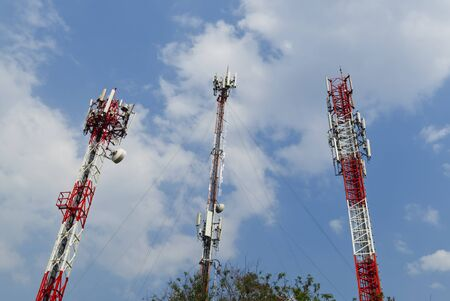 Cell Site Pole, Digital Telecommunication Antenna in Blue Sky Background.
