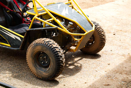 Muddy Buggy Parked in the Parking Lot After a Heavy Dirt Race.