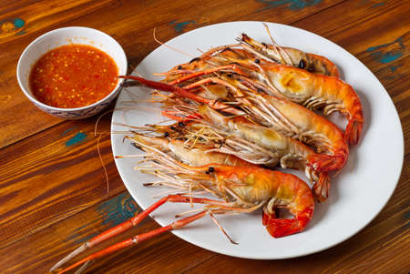 Roasted, Grilled Prawn on the Wood Table, Fresh Seafood shrimp Tasty Meal.