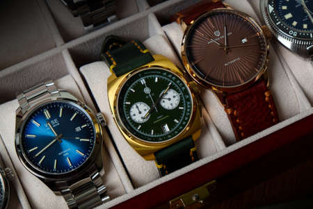 2021-06-01 Various Collection of Wrist Watches in the Watches Box on the Wood Table in Bangkok, Thailand.