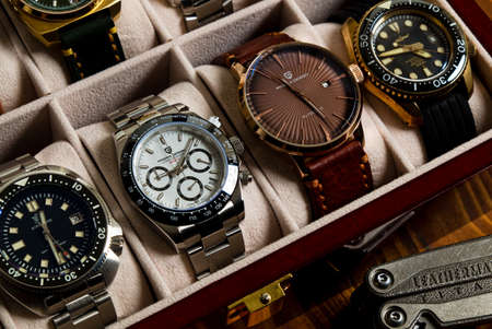 2021-06-02 Various Collection of Homage Wrist Watches in the Watches Box on the Wood Table in Bangkok, Thailand.