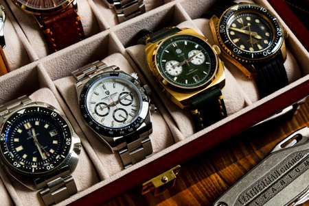2021-06-02 Various Collection of Wrist Watches in the Watches Box on the Wood Table in Bangkok, Thailand.