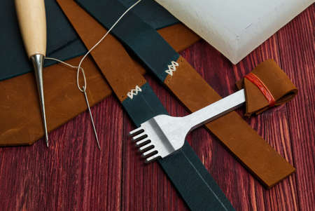 Handmade Genuine Leather Wrist Watch Strap, Tools or Sewing Wallets, Clutches or Another Genuine Leather Products. 版權商用圖片