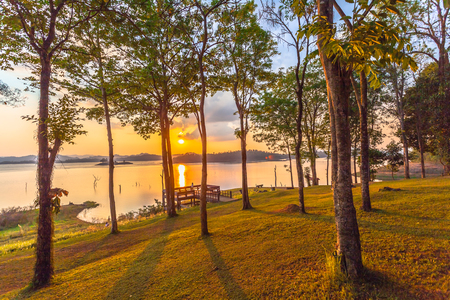 Stunning panoramic view of the lake in sunset time. light through the sky to the lake
