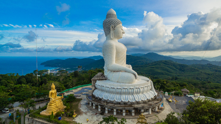 blue sky and blue ocean are on the back of Phuket Big Buddha statue.white Phuket big Buddha is the one of landmarks on Phuket island.
