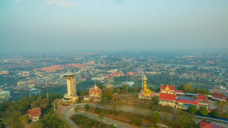 aerial photography sunrise around the golden pagoda of Kiriwong temple on the high mountain. Wat Kiriwong is the most beautiful temple in Pak Nam Pho Nakorn Sawan province Thailand