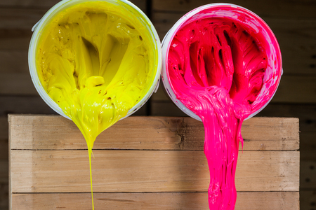 pink and yellow colors of Plastisol ink. ink for print on tee shirt and print on any fabric. Plastisol ink useful in tee shirt factory garment and industry for export