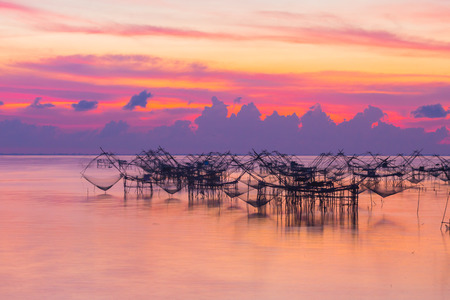 scenery sunshine above  fishing trap at Pak Pra lagoon in Talay Noi Phaphalung province Thailand. Banco de Imagens