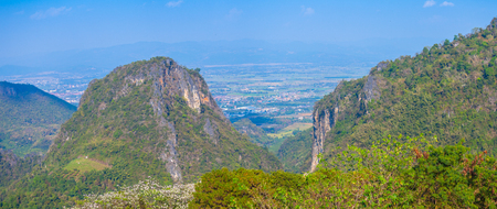 panorama at Doi Pha Mee view point you can see Doi Nangnon in Maesai Chiang Rai shape of mountains look like women sleeping. inside of Doi Nang Non have big and long cave childrens lost in this cave.