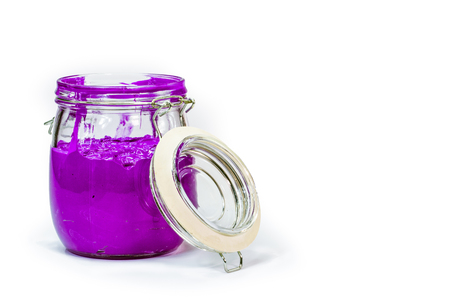 purple color of plastisol ink in white background fill in transparent bottle.plastisol ink is specially for print on tee shirts and any fabric Stock Photo