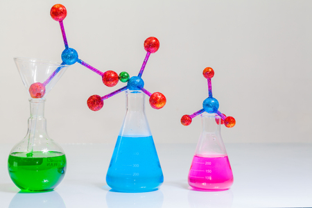 Lab experiments molecule structure with chemical experiment tube In the science lab with white background.