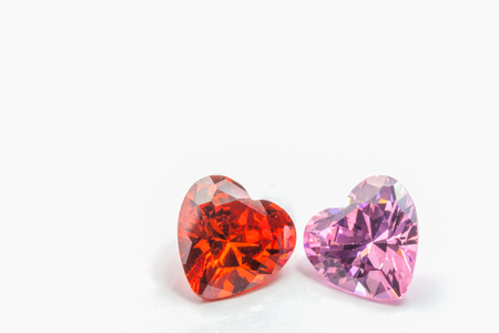 topaz gemstones and pink sapphires in heart shape on white background for valentine day Stock Photo