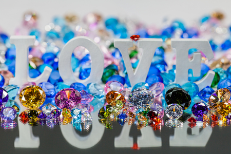 The word love is located on the area of colorful diamonds and.  the word love is love for Valentine's Day.
