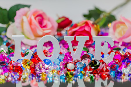 The word love is located on the area of colorful diamonds and roses, the word love is love for Valentine's Day.